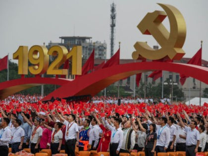 BEIJING, CHINA - JULY 01: Members of the audience stand and applaud Chinese President and Chairman of the Communist Party Xi Jinping, not seen, during his speech at a ceremony marking the 100th anniversary of the Communist Party at Tiananmen Square on July 1, 2021 in Beijing, China. (Photo by …