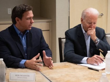 """US President Joe Biden alongside Florida Governor Ron DeSantis (L) speaks about the collapse of the 12-story Champlain Towers South condo building in Surfside, during a briefing in Miami Beach, Florida, July 1, 2021. - President Joe Biden flew to Florida on Thursday to """"comfort"""" families of people killed or …"""
