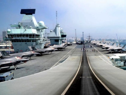This picture taken on July 1, 2021 shows a view of the take-off ramp of the Royal Navy's HMS Queen Elizabeth aircraft carrier while moored in the new port of Cyprus' southern city of Limassol. - HMS Queen Elizabeth, the largest warship ever built for the Royal Navy, docks at …