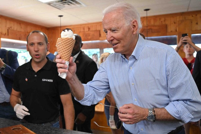 US President Joe Biden eats ice cream at Moomers Homemade Ice Cream in Traverse City, Michigan on July 3, 2021. (Photo by MANDEL NGAN / AFP) (Photo by MANDEL NGAN/AFP via Getty Images)