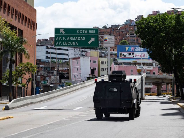 Members of the Special Actions Forces command (FAES) aboard an armored vehicle drive along a main avenue of Caracas during clashes against alleged members of a criminal gang in the surroundings of La Cota 905 neighborhood, on July 8, 2021. - A new clash between police and criminal gangs has …