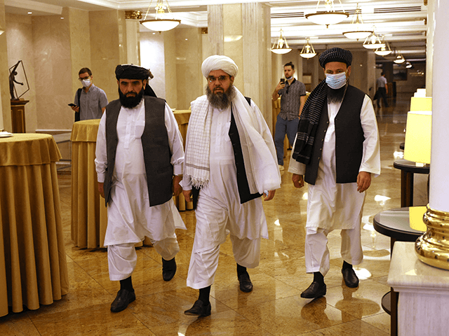 Leaders of the Taliban movement and negotiators Abdul Latif Mansoor (R), Shahabuddin Delawar (C) and Suhail Shaheen (L) walk to attend a press conference in Moscow on July 9, 2021. - Russia on July 9, 2021, said the Taliban controls about two-thirds of the Afghan-Tajik border and urged all sides in Afghanistan to show restraint. (Photo by Dimitar DILKOFF / AFP) (Photo by DIMITAR DILKOFF/AFP via Getty Images)