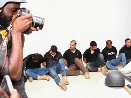 Suspects in the assassination of Haitian president Jovenel Moise are presented to the media by Hatian authorities in Port-au-Price on July 8, 2021. - A 28-member hit squad made up of Americans and Colombians assassinated President Jovenel Moise, Haitian police said Thursday, adding that eight were still at large as …