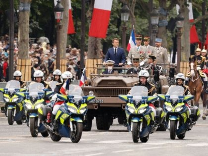 French President Emmanuel Macron and French Armies Chief of Staff General Francois Lecointre stand in the command car as they review the troops during the annual Bastille Day military parade on the Champs-Elysees avenue in Paris on July 14, 2021. (Photo by Ludovic MARIN / POOL / AFP) (Photo by …