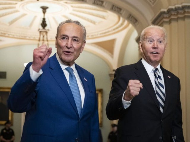 WASHINGTON, DC - JULY 14: Senate Majority Leader Chuck Schumer (D-NY) and U.S. President Joe Biden speak briefly to reporters as they arrive at the U.S. Capitol for a Senate Democratic luncheon July 14, 2021 in Washington, DC. President Biden is on the Hill to discuss with Senate Democrats the …