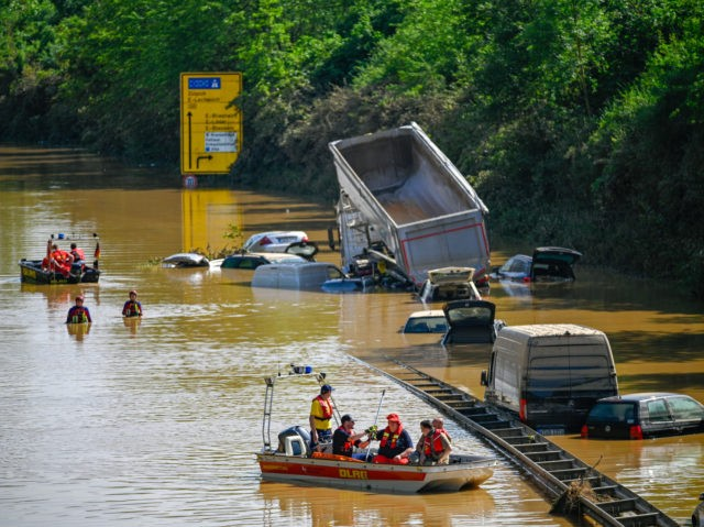 ERFTSTADT, GERMANY - JULY 17: Search and rescue teams are seen on a flooded and damaged part of the highway (A1) on July 17, 2021 in Erftstadt, Germany. The death toll in western Europe rose to 150 after record rainfall this week caused rivers to burst their banks, resulting in …