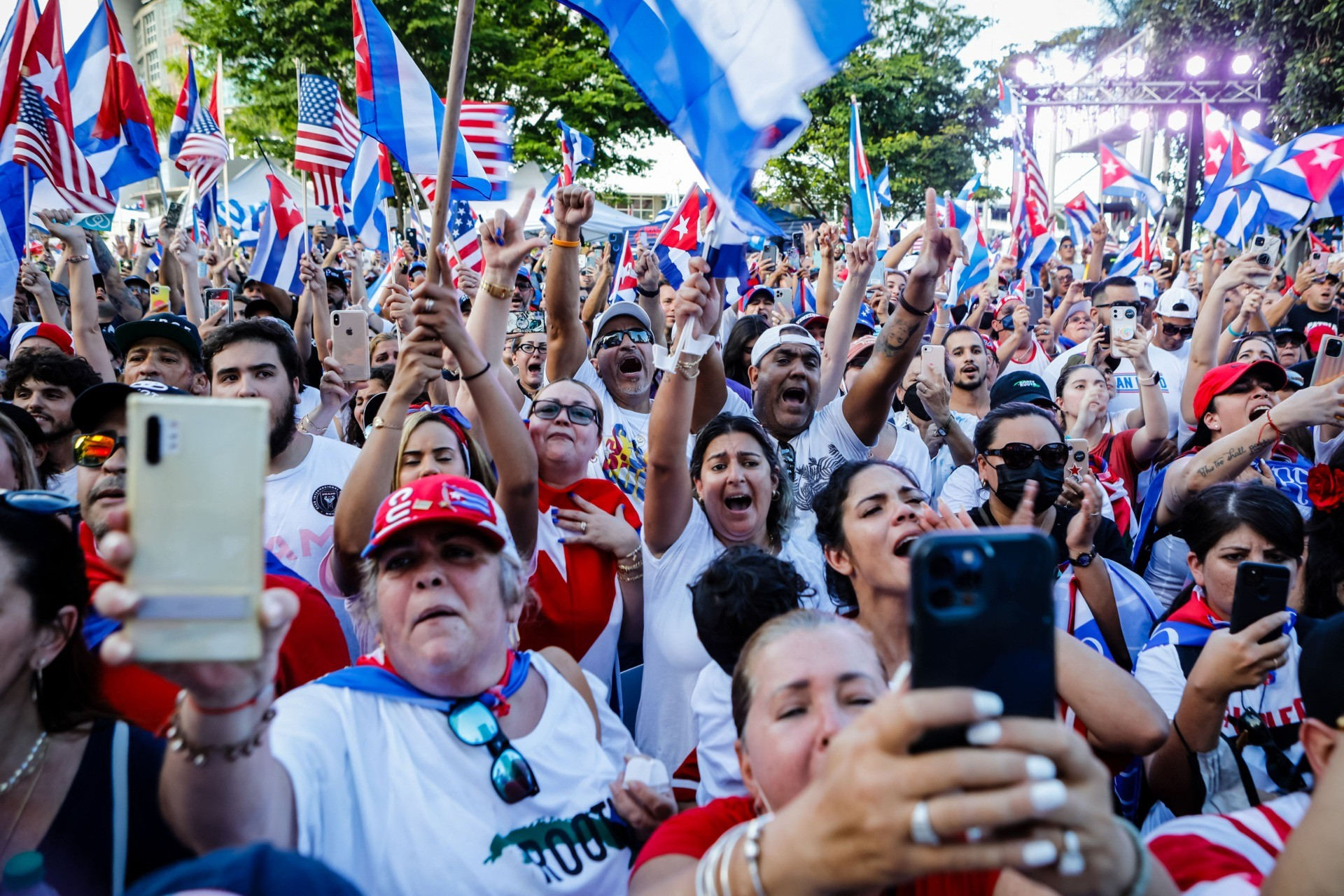 People wave Cuban and US flags during a Freedom Rally showing support for Cubans demonstrating against their government, at Freedom Tower in Miami, on July 17, 2021. - Cuba's President Miguel Diaz-Canel on July 17, denounced what he said was a false narrative over unrest on the Caribbean island, as the Communist regime vigorously pushed back against suggestions of historically widespread discontent. (Photo by Eva Marie UZCATEGUI / AFP) (Photo by EVA MARIE UZCATEGUI/AFP via Getty Images)