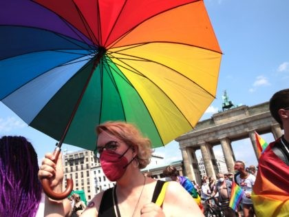 BERLIN, GERMANY - JULY 24: Participants take part in the annual Christopher Street Day parade on July 24, 2021 in Berlin, Germany. The Christopher Street Day parade is held in memory of the first big uprising of the gay community against police assaults in New York's Greenwich Village in June, …