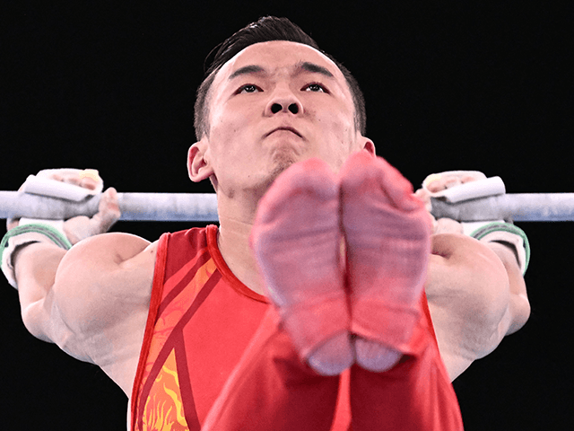 China's Wei Sun competes in the horizontal bar event of the artistic gymnastics men's all-around final during the Tokyo 2020 Olympic Games at the Ariake Gymnastics Centre in Tokyo on July 28, 2021. (Photo by Lionel BONAVENTURE / AFP) (Photo by LIONEL BONAVENTURE/AFP via Getty Images)