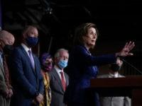 Watch: Nancy Pelosi Breaks Her Own Indoor Mask Mandate Twice