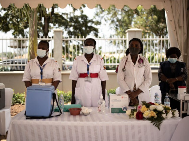 KAMPALA, UGANDA - MARCH 10: Healthcare workers take a brief moment of silence to remember colleagues who have succumbed to coronavirus on March 10, 2021 in Kampala, Uganda. Uganda began phase one of COVID-19 vaccinations today after receiving their first batch of 864,000 doses of the AstraZeneca vaccine from the …