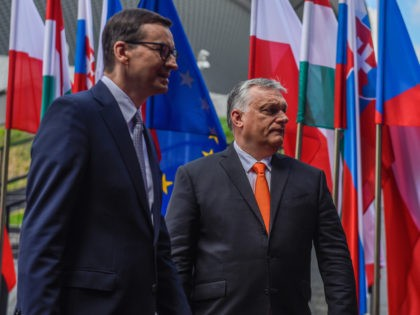 KATOWICE, POLAND - JUNE 30: Poland's Prime Minister, Mateusz Morawiecki welcomes the Prime Minister of Hungary, Viktor Orban during a Heads of State meeting of the Visegrad group at International Congress Center on June 30, 2021 in Katowice, Poland. The heads of state of Poland, Hungary, Slovakia and the Czech …