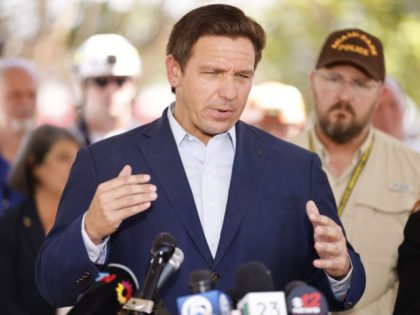 SURFSIDE, FLORIDA - JULY 03: Florida Gov. Ron DeSantis speaks to the media about the 12-story Champlain Towers South condo building that partially collapsed on July 03, 2021 in Surfside, Florida. Over one hundred people are being reported as missing as the search-and-rescue effort continues. (Photo by Michael Reaves/Getty Images)