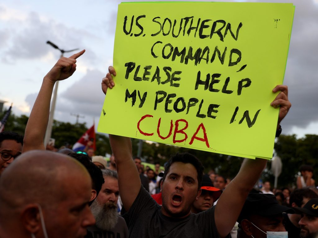 MIAMI, FLORIDA - JULY 11: Protesters gather in front of the Versailles restaurant to show support for the people in Cuba who have taken to the streets there to protest on July 11, 2021 in Miami, Florida. Thousands of Cubans took to the streets across the country to protest pandemic restrictions, the pace of Covid-19 vaccinations and the Cuban government. (Photo by Joe Raedle/Getty Images)