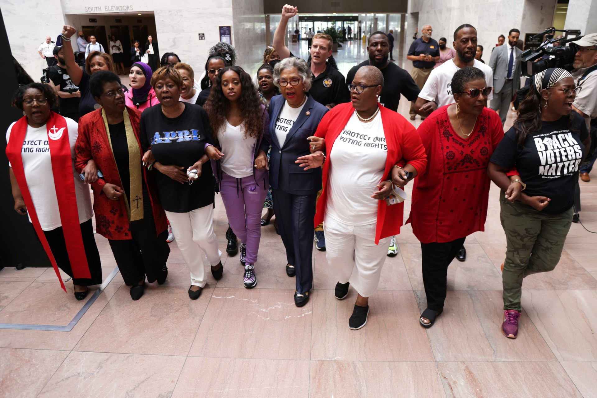 """WASHINGTON, DC - JULY 15: Voting Rights activists, led by U.S. Rep. Joyce Beatty (D-OH) (C) and Chair of Congressional Black Caucus (CBC), stage a protest at Hart Senate Office Building July 15, 2021 on Capitol Hill in Washington, DC. The activists participate in a civil disobedience in response to """"numerous voter restriction laws being passed in states across the country, as well as Senate Republicans' refusal to engage meaningfully in drafting federal legislation to ensure that every American has equal access and opportunity to vote."""" (Photo by Alex Wong/Getty Images)"""