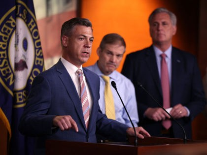 WASHINGTON, DC - JULY 21: Rep. Jim Banks (R-IN) (L), joined by Rep. Jim Jordan (R-ON) (C) and House Minority Leader Kevin McCarthy (R-CA) speaks at a news conference on House Speaker Nancy Pelosi's decision to reject two of Leader McCarthy's selected members from serving on the committee investigating the …
