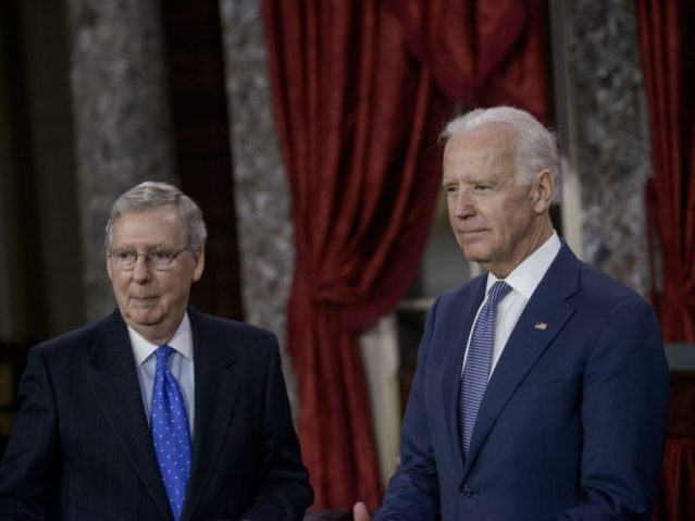 Senate Majority Leader Senator Mitch McConnell (R-KY) and US Vice President Joseph R. Biden(R) participate in a mock swearing-in in the Old Senate Chamber on Capitol Hill January 6, 2015 in Washington, DC. The 114th Congress convened today with Republicans taking majority control of both the Senate and House of Representatives. AFP PHOTO/BRENDAN SMIALOWSKI (Photo credit should read BRENDAN SMIALOWSKI/AFP via Getty Images)
