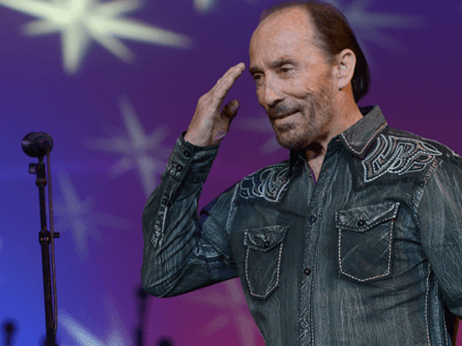 Singer/Songwriter Lee Greenwood performs during Lipscomb University's Copperweld Charlie Daniels' Scholarship for Heroes event at Allen Arena, Lipscomb University on March 25, 2014 in Nashville, Tennessee. (Photo by Rick Diamond/Getty Images)