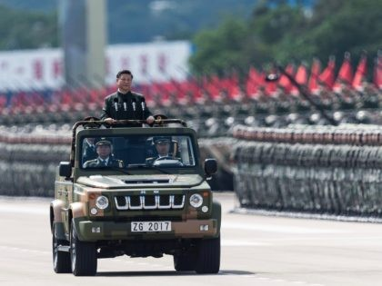 China's President Xi Jinping inspects People's Liberation Army soldiers at a barracks in Hong Kong on June 30, 2017. - Xi tours a garrison of Hong Kong's People's Liberation Army garrison as part of a landmark visit to the politically divided city. (Photo by DALE DE LA REY / AFP) …