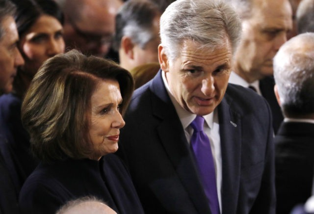 WASHINGTON, DC - FEBRUARY 28: (AFP-OUT) House Majority Leader Kevin McCarthy (R-CA) speaks with Minority Leader Nancy Pelosi (D-CA) as they wait for the start of ceremonies as the late evangelist Billy Graham lies in repose at the U.S. Capitol, on February 28, 2018 in Washington, DC. Rev. Graham is …