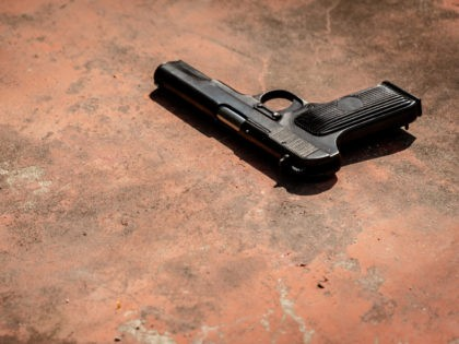 Old russian Auto Pistol on the concrete red backgroound