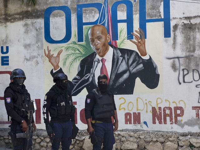 Haitian police control the area next to a painting of Haiti's President Jovenel Moise next to his private residence in Port-au-Prince, Haiti, Wednesday, July 7, 2021. Mo'se was assassinated after a group of unidentified people attacked his private residence, the country interim prime minister said in a statement, Mo'se's wife, …