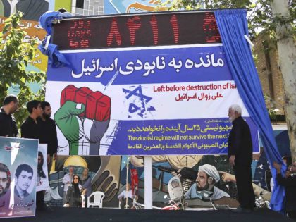 Iran countdown clock Israel (Ebrahim Noroozi / Associated Press)