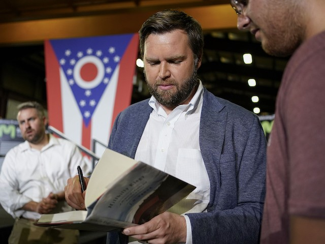 """JD Vance, the venture capitalist and author of """"Hillbilly Elegy"""", speaks with supporters following a rally Thursday, July 1, 2021, in Middletown, Ohio, where he announced he is joining the crowded Republican race for the Ohio U.S. Senate seat being left by Rob Portman. (AP Photo/Jeff Dean)"""