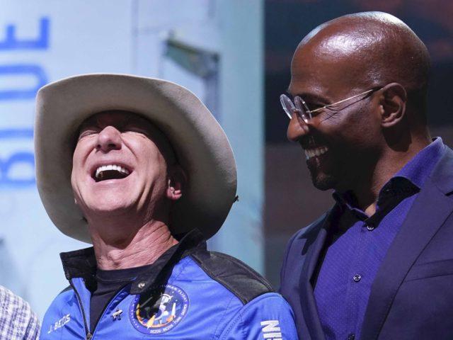 Jeff Bezos and Van Jones (Tony Gutierrez / Associated Press)