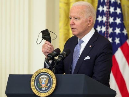 WASHINGTON, DC - JULY 29: U.S. President Joe Biden holds up a face mask as he delivers remarks in the East Room of the White House on July 29, 2021 in Washington, DC. President Biden spoke on his administration's effort to get more Americans vaccinated and plan to combat the …