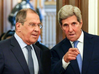 Russian Foreign Minister Sergei Lavrov (L) welcomes US climate envoy John Kerry (R) for a meeting in Moscow on July 12, 2021. (Photo by Dimitar DILKOFF / POOL / AFP) (Photo by DIMITAR DILKOFF/POOL/AFP via Getty Images)