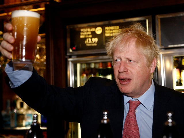 LONON, ENGLAND - JULY 10: Boris Johnson, a leadership candidate for Britain's Conservative Party holds a pint of beer as he meets with JD Wetherspoon chairman, Tim Martin at Wetherspoons Metropolitan Bar on July 10, 2019 in London, England. (Photo by Henry Nicholls WPA Pool/Getty Images)