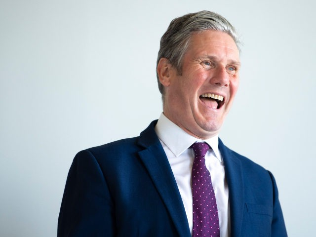 BRISTOL, ENGLAND - MAY 27: Leader of the Labour Party Keir Starmer laughs during a visit to the SGS WISE Campus on May 27, 2021 in Bristol, England. The West of England's new metro mayor Dan Norris was elected in May's elections and is being joined on a jobs visit …