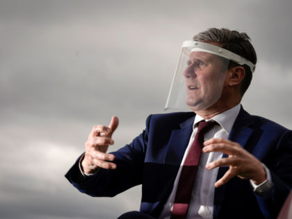 NOTTINGHAM, ENGLAND - JULY 16: Labour Party leader, Sir Keir Starmer, wears a face visor during talks with care home workers and family members of residents during a visit to Cafe 1899 in Gedling Country Park on July 16, 2020 in Nottingham, England. The opposition leader discussed the impact of …