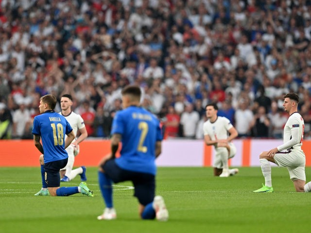 LONDON, ENGLAND - JULY 11: Nicolo Barella of Italy and Mason Mount of England take a knee in support of the Black Lives Matter movement prior to the UEFA Euro 2020 Championship Final between Italy and England at Wembley Stadium on July 11, 2021 in London, England. (Photo by Paul …
