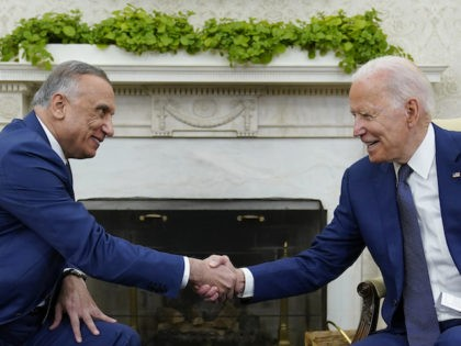 President Joe Biden, right, shakes hands with Iraqi Prime Minister Mustafa al-Kadhimi, left, during their meeting in the Oval Office of the White House in Washington, Monday, July 26, 2021. (AP Photo/Susan Walsh)