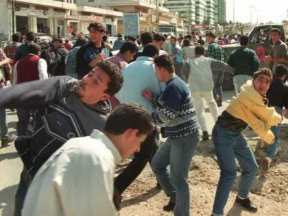 Palestinian Youths Throw Rocks at Israelis