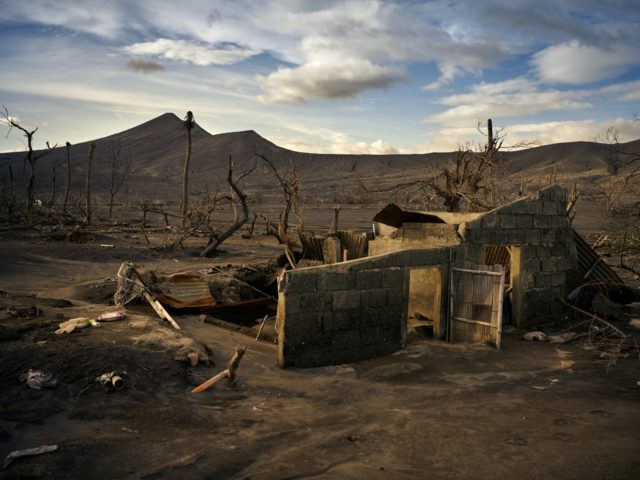 BALETE, PHILIPPINES - DECEMBER 15: A destroyed house at the foothills of the volcano on December 15, 2020 in Balete, Batangas, Philippines. The Taal volcano, which erupted in January and caused earthquakes, lava flows and plumes of ash to rise to the sky, left the areas around it devastated and …