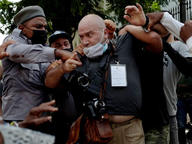 """AP photographer, Spanish Ramon Espinosa, is attacked by the police while covering a demonstration against Cuban President Miguel Diaz-Canel in Havana, on July 11, 2021. - Thousands of Cubans took part in rare protests Sunday against the communist government, marching through a town chanting """"Down with the dictatorship"""" and """"We want liberty."""" (Photo by Adalberto ROQUE / AFP) (Photo by ADALBERTO ROQUE/AFP via Getty Images)"""