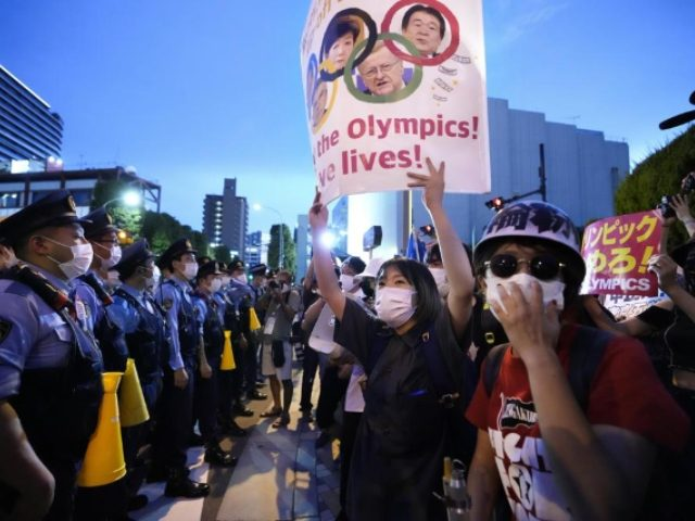 'Go To Hell Olympics': Protesters Pack the Streets Before Opening Ceremony