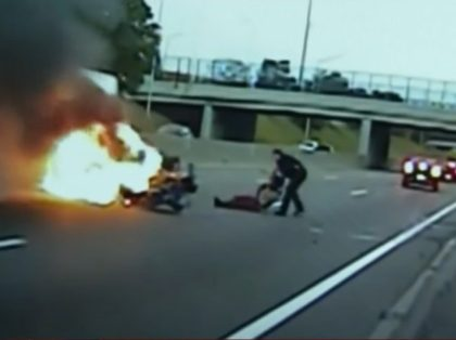 Harper Woods, MI public safety officer pulls man from burning vehicle. Screenshot via YouTube.