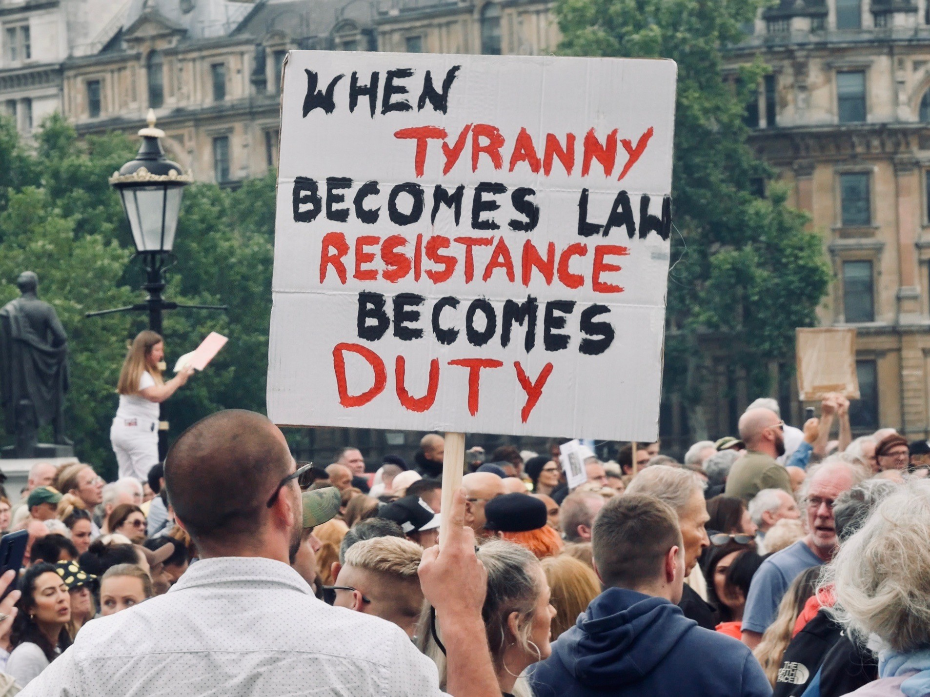 """A protester holds a placard reading """"When tyranny becomes the law, resistance becomes duty"""" at the Freedom Rally in London's Trafalgar Square, July 24th, 2021. Kurt Zindulka, Breitbart News"""
