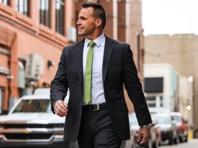 Sheriff Chris Swanson of Genesee County in Michigan walking down the street