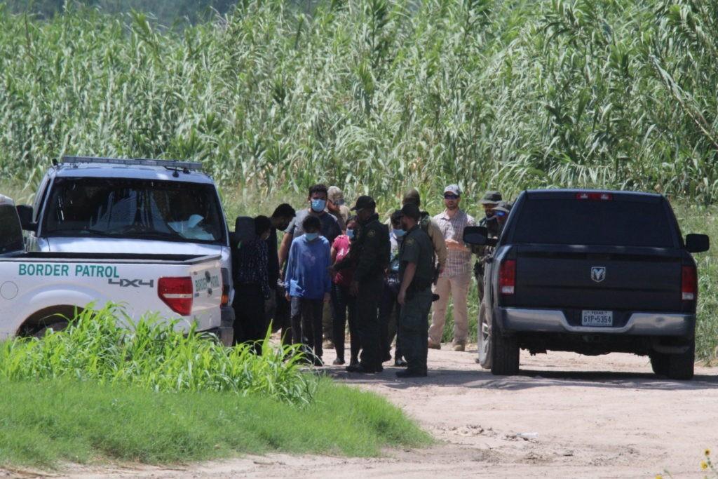 Eagle Pass Station Border Patrol agents process a group of migrants near the RIo Grande. (Photo: Randy Clark/Breitbart Texas)