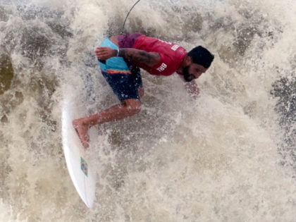 Brazil's Italo Ferreira maneuvers on a wave during the quarterfinals of the men's surfing competition at the 2020 Summer Olympics, Tuesday, July 27, 2021, at Tsurigasaki beach in Ichinomiya, Japan. (AP Photo/Francisco Seco)