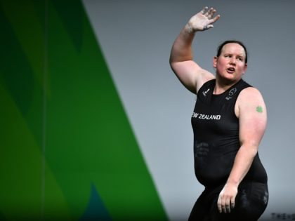 GOLD COAST, AUSTRALIA - APRIL 09: Laurel Hubbard of New Zealand waves to the crowd after a failed attempt in the Women's +90kg Final during the Weightlifting on day five of the Gold Coast 2018 Commonwealth Games at Carrara Sports and Leisure Centre on April 9, 2018 on the Gold …