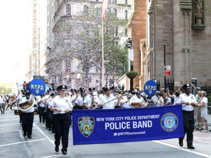 """NEW YORK, NEW YORK - JULY 07: New York City Police Department Police Band walk during the """"Hometown Heroes"""" Ticker Tape Parade on July 07, 2021 in New York, New York. Healthcare Workers, first responders and essential workers are honored in Manhattan's Canyon of Heroes for their service during the …"""