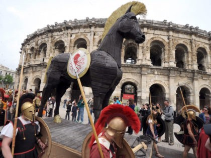 TO GO WITH AFP STORY BY REMY ZAKA - People parade with a Trojan horse during an historical reenactment in front of the amphitheatre as part of the third edition of the Roman Games on April 28, 2012 in Nimes, southern France. The event, that focused this year on the …