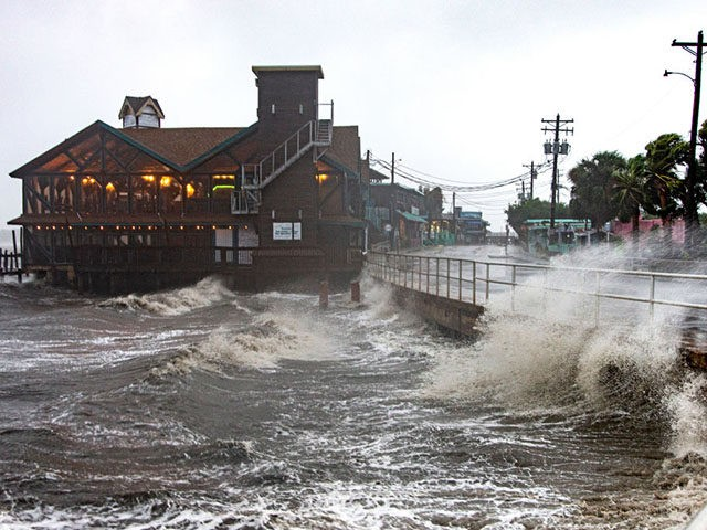 CEDAR KEY, FL - JULY 07: Tropical Storm Elsa makes landfall on July 7, 2021 in Cedar Key, Florida. Storm warnings remain in effect for parts of Florida's west coast as Tropical Storm Elsa made landfall on Wednesday morning. After hitting Cuba on Monday, causing flooding and mudslides, Elsa is …