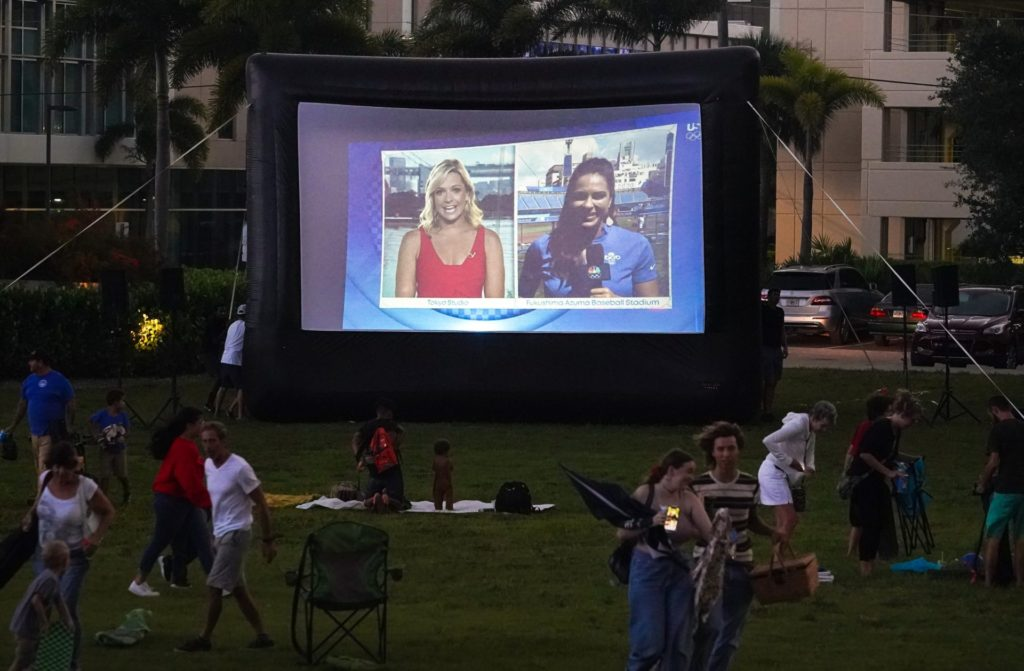 An untimely downpour scatters spectators at a Monday, July 26, 2021, watch party for Jake Ilardi's Olympic competition in Sarasota, Florida. Ilardi is representing the United States at the Tokyo Olympics while competing in street skateboarding. Syndication Sarasota Herald Tribune